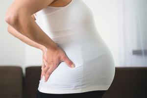Боль в копчике при беременности